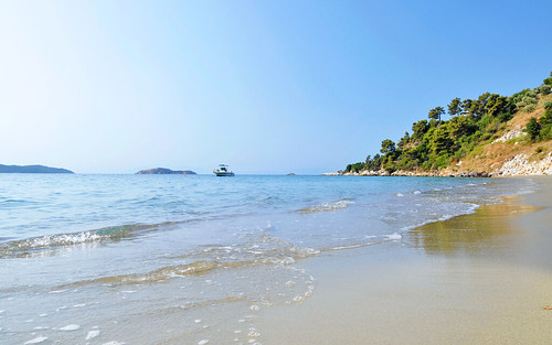 Clear waters and golden sands at Vasilias Beach in Skiathos | by KB Collection Hotels & Resorts