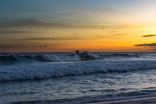 scenic seascape beach sunset surfer fortwaltonbeach florida unitedstates us