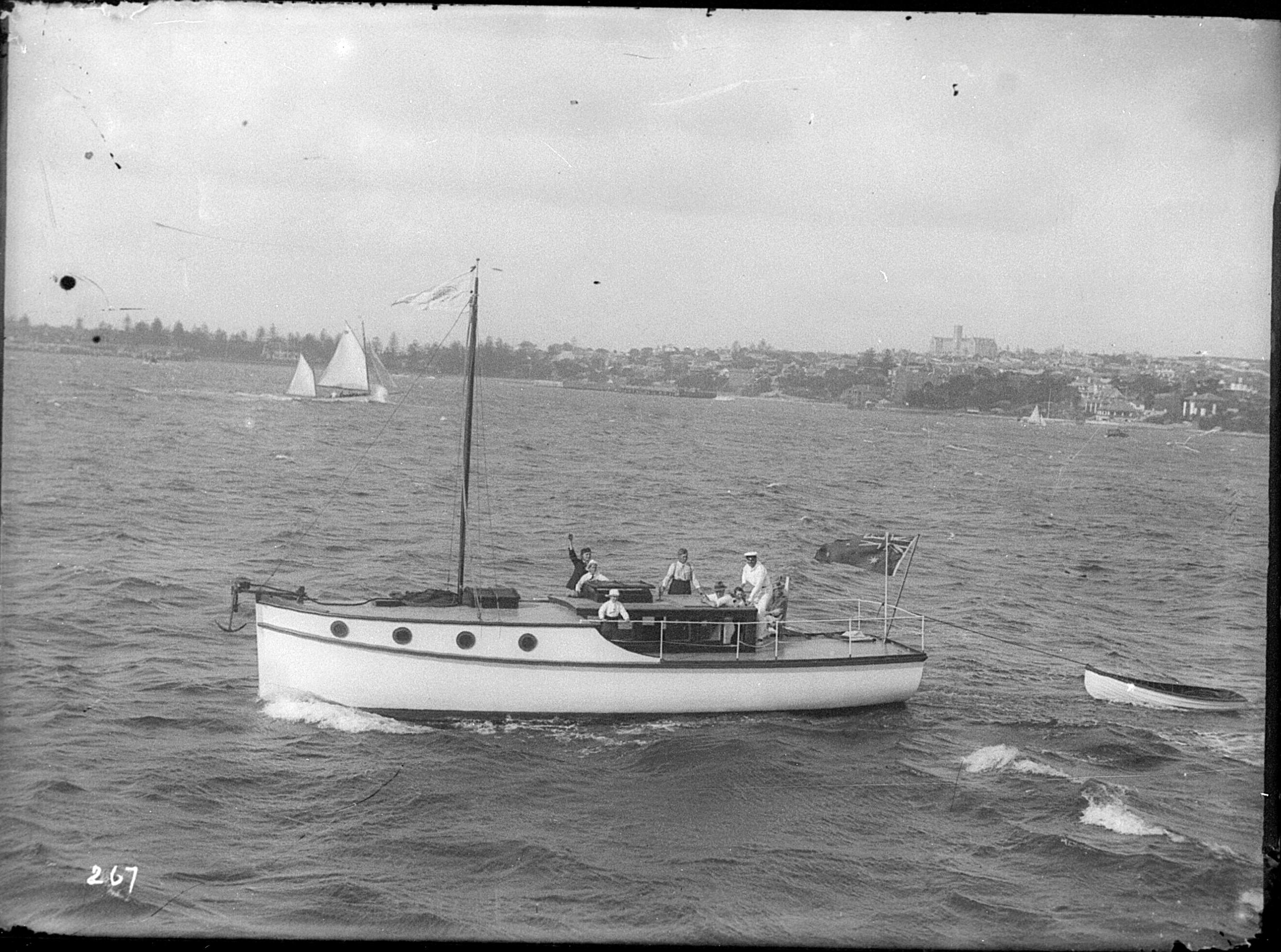 Raised deck motorlaunch near Manly, Sydney