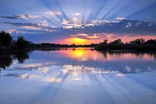sunset reflections kansas rays wichita chisholmcreekpark