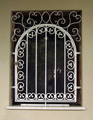 A window with a painted wrought-iron grill, Casteldaccia, Sicily