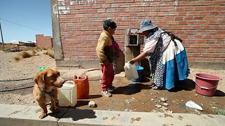 A public faucet that serves 1000 families in el Alto, Bolivia   by World Bank Photo Collection
