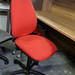 Red fabric swivel chair €55