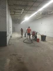 Sanding the floor in the new space