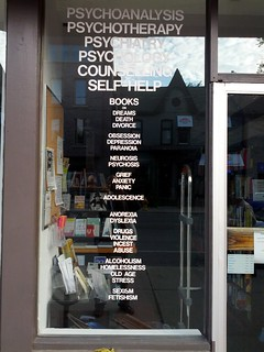 Psychotherapy bookstore window subject list, Harbord Street, Toronto, Ontario, Canada   by gruntzooki