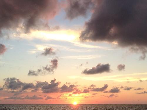 sunset sky usa sun gulfofmexico water pine clouds island day florida cloudy fl