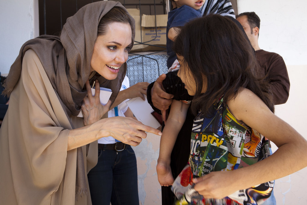 Image result for Angelina Jolie with refugees