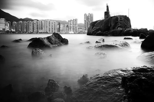 fujifilm xe2 xf1855mmf284rlmois fujinon hongkong blackandwhite monochrome slowshutter longexposure city buildings sea water rocks lighttower landscape