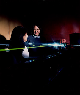 Physics Professor Alma Zook with what is likely an argon ion laser, acquired in 1990