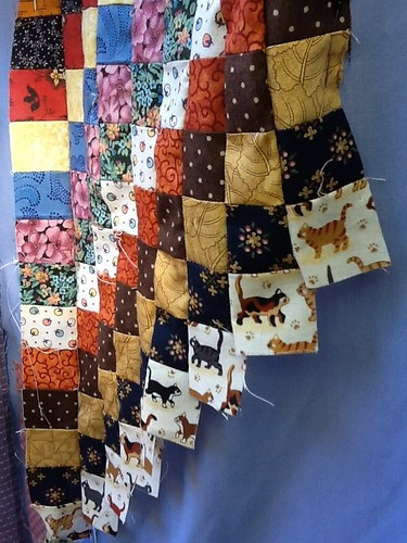 Autumn colors and kitties are drifting into the quilt top today