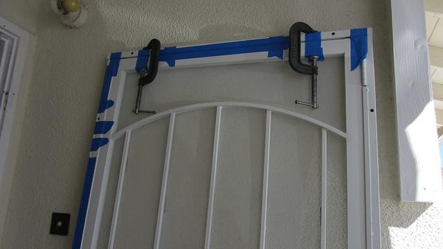 IMG_1798 spacers between metal screen door and frame