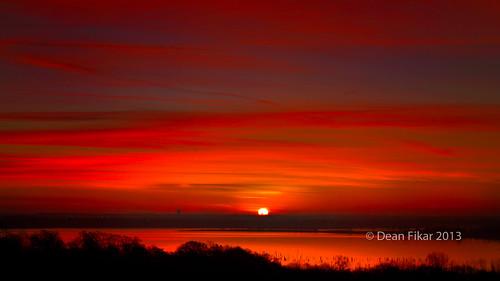 winter orange sun lake tower crimson clouds rural sunrise pond colorful panoramic serene treesilhouettes