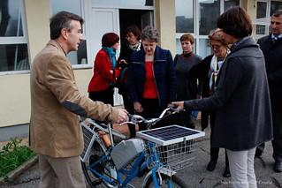 Helen Clark with a solar-power bicycle | by UNDP in Europe and Central Asia