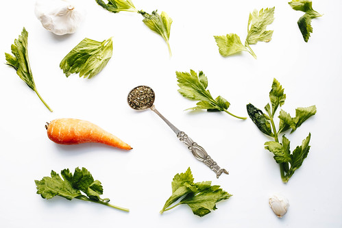 Flat lay with vegetables. Celery leaves, carrot, oregano and garlic. | by wuestenigel
