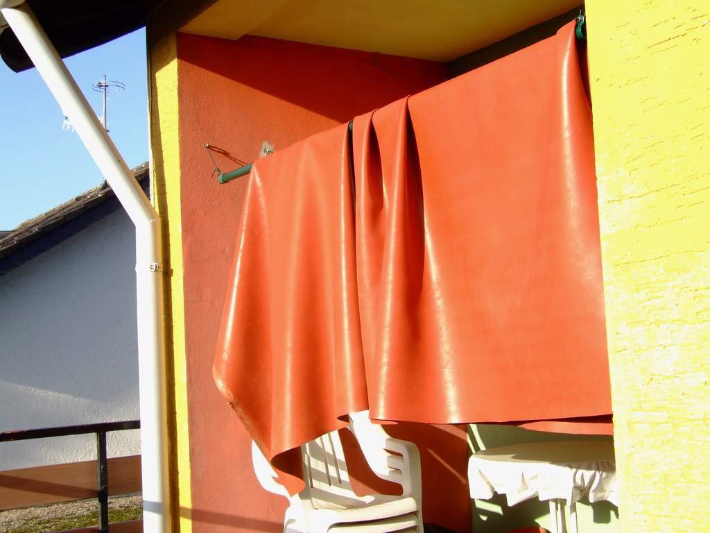Dscf3845 Large Old Red Rubber Bed Sheets Drying Outside