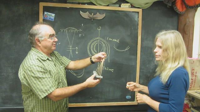 MVI_2644 SBAU tim explain parabola light focus on blackboard