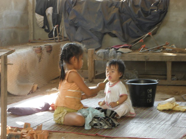 Children at a weaving factory in Laos