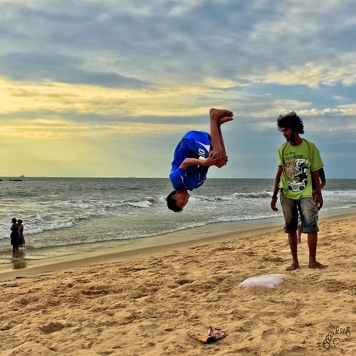 sunset jump fisheye acrobatics dancemoves dancetroupe spacewarp sandwater canon600d oceankidsmangalore
