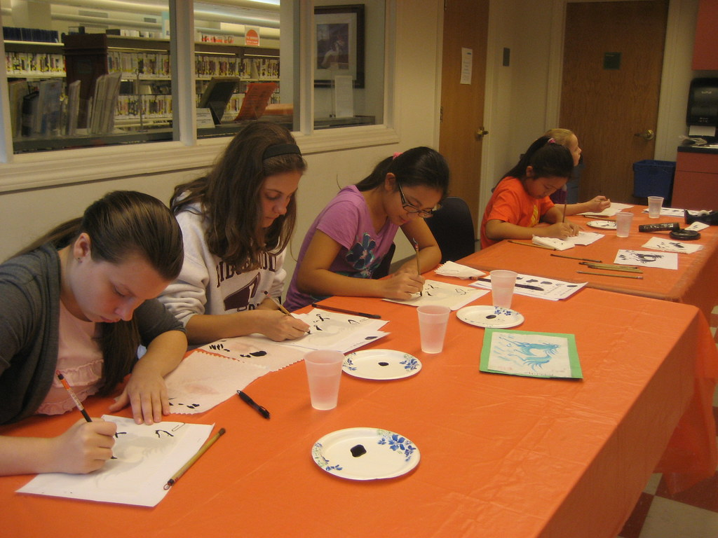 Patrons completing an art project in a public library