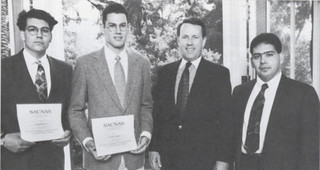 Jaime Angulo '97, Jorge Ramirez '97, President Peter Stanley and Professor Roberto Garza, when Angulo and Ramirez won the Vigil Award at the annual conference for the Society for Advancement of Chicanos and Native Americans in Science in 1994.