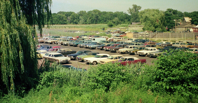 The Surf Club parking lot in the late afternoon with lots of colorful 1960s and 1970s cars. Vinyl roof heaven! Taken from one of the new houses being built on Seabreeze Avenue. Milford Connecticut. Aug 1974.