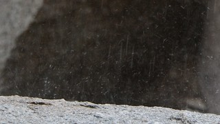 1133 Zoomed-in view of raindrops splattering on granite as I waited for the rain to stop | by _JFR_