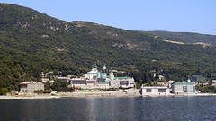Greece, Macedonia, Aegean Sea, Saint Panteleimon  monastery view from a boat cruising around Mount Athos peninsula