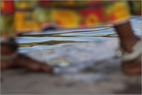 zaveri people mp india narmada madhyapradesh photography photographer photos blog holy stockimages river rivers photograph photographs nevil nevilzaveri stock photo landscape ghat bank water omkareshwar woman women anklet reflectio feet legs myfav color image