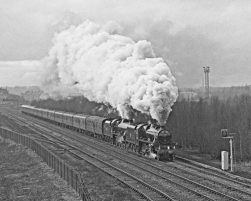 Another loco with Kingmoor connections, 44767 pilots 45596 at Durranhill Junction with a Southbound CME. 44767 was withdrawn from BR service at 12A in December 1967.