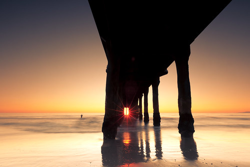 ocean california sunset man beach window silhouette stone last standing reflections pier long exposure pacific manhattan under hedge flare