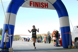 Mary Flood, the female winner crosses the finish line. | by NCDOTcommunications