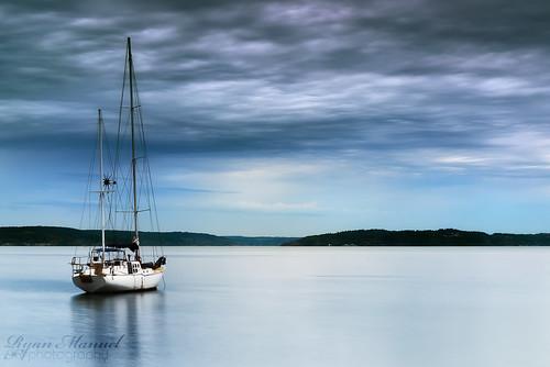 sunset storm water clouds sailboat boat washington nikon wa pugetsound tacoma washingtonstate rustonway commencementbay singhray leefilters d800e