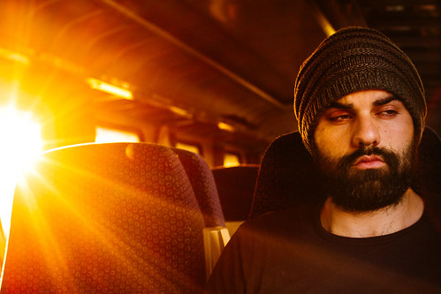 train international tired exhausted sunrise sun warm 2016 burst face portrait confused golden seated sat window