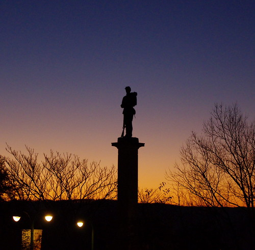 morning blue trees light sky orange public silhouette statue sunrise soldier outdoors bare greensburg westmoreland