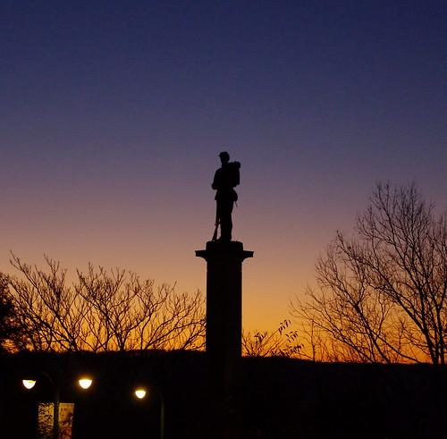 morning blue trees light sky orange public silhouette statue sunrise soldier outdoors bare greensburg westmoreland