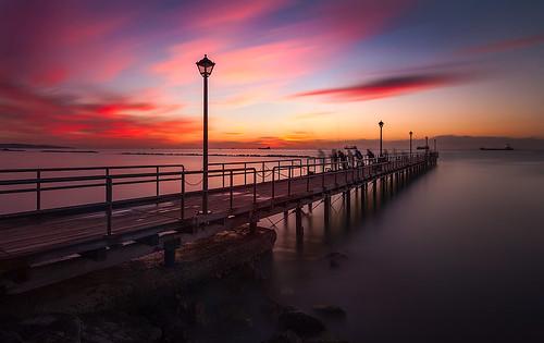 sea clouds sunrise pier nikon rocks limassol d700 tokina1116