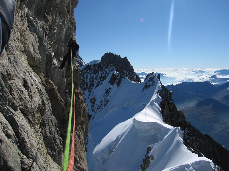 Abseiling off the Dent du Géant with the Rochefort Arete in the background