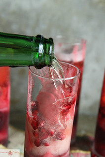 Raspberry Pomegranate Champagne Cocktail | by Heather Christo