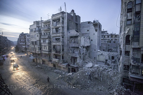 Dar Al-Shifa hospital (seen partially to the right of the frame) was bombed by a plane. The hospital had been bombed and shelled more than 20 times and was clearly a target for the Assad forces. The hospital had turned into a symbol of resistance. | by FreedomHouse
