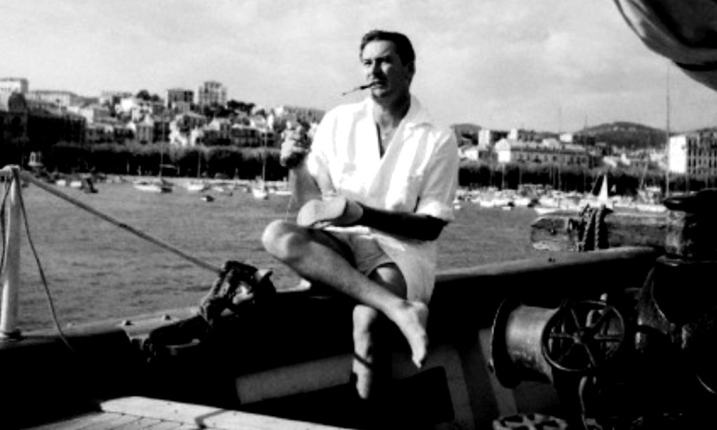 Errol Flynn on his boat around 1950.