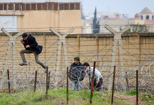 A Syrian man jumps over barbed wire as he tries to cross the border from the Syrian town of Ras al-Ain to the Turkish border town of Ceylanpinar, Sanliurfa province, on December 6, 2012. (Reuters/Laszlo Balogh) | by FreedomHouse