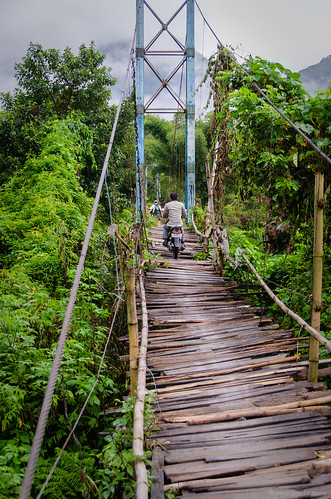 A motorbike on a wooden bridge … safe ? | by Jerome Nicolas
