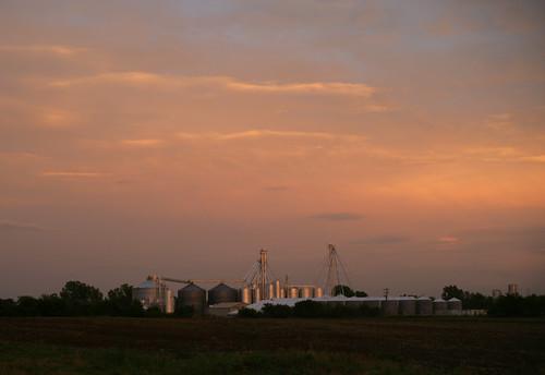 sunset clouds landscape farm farming grain storage silo kansas chanute agroculture