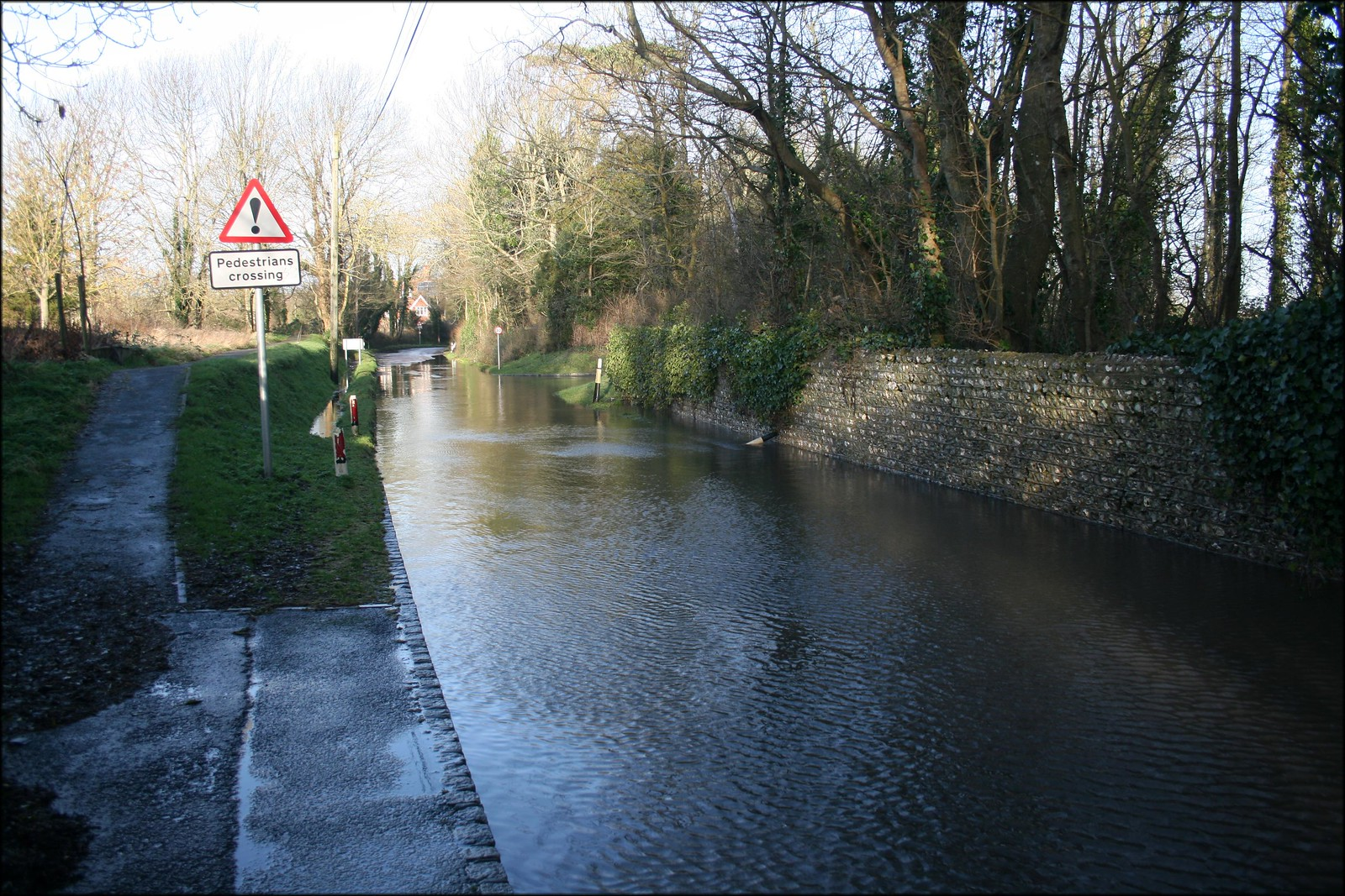 Firle Flooded street in Firle, East Sussex. I was glad the pavement was raised here.