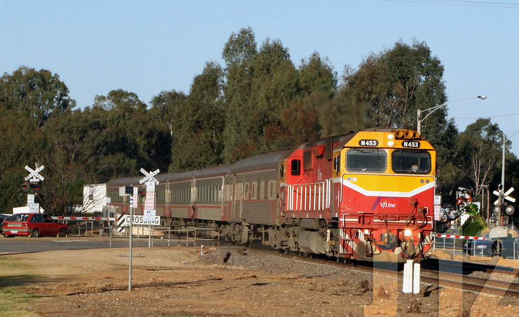 N453 powers through a level crossing in Wangaratta, with what looks like Santa Clause at the helm ~19.10.12 by James 460