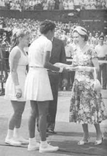 Queen Elizabeth II congratulates 1957 Wimbledon singles champion Althea Gibson and runner-up Darlene Hard '61. Gibson and Hard won the doubles title.