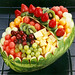 An artfully prepared arrangement of sparkling fresh fruits including juicy fresh strawberries, pineapple, grapes, kiwi slices and melon balls in a beautiful decorative watermelon basket.