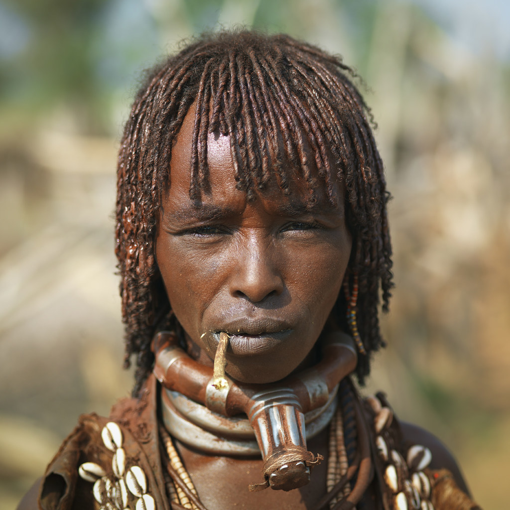 Hamer Woman With Braided Dyed Hair Chewing Siwak, Omo valley,  Ethiopia