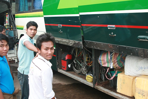Myanmar, Yangon -  Feb 2013 - Loading our bikes in a frenzized rush after a 25km bikeride out to the ridiculously located Highway Bus Station past the airport.  We overnight bussed from Yangon to Kalau up in the mountains of Shan state, one day's bike rid