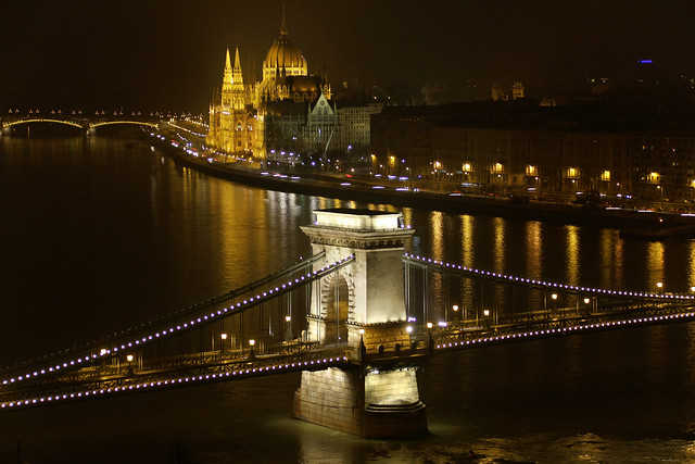 Budapest - chain bridge pillar with the parliament at night